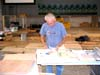 Eugene Esters, our technical leader, working at his desk which just happens to be one of our three table saws.