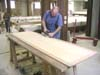 Jim Strong works on one of the dining room tables we made for Pineywoods.
