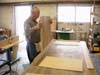 Eugene Esters is assembling one of many frames to use in the shelf and counter assemblies.