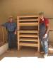 Richard Brewer and Smitty Qualls standing by one of many headboards they assembled.