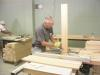 Melvin Williamson, our leader, is cutting tenons on the ends of headboard pieces.