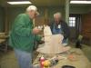 Rex Taylor and Coy Hearin are putting the finishing touches on one of our most important products, a childs rocking chair.