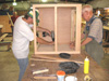 Larry Day and Lee Harrison putting the final touches on a file drawer assembly.
