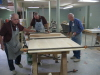 Melvin Warren, Harold Cheatheam and Richard Brewer gluing up a table top