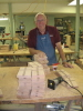 Loyd Ervin bevels the edges of the crosses we use in assembling the bed safety rails