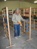 Richard Brewer is putting the finishing touches on a bunk bed headboard