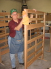 Larry Frantzen is doing a final wipedown of a bunk bed headboard prior to its being painted