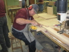 Melvin Warren is doing an excellent job sanding the edges of cabinet doors