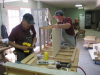 Richard Adcock and Lynn Turner assemble a cabinet
