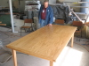 Buddy Nafe is doing a last and final check of a new table before delivery