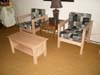 Two cargo chairs and a coffee table that we've just finished being used in their motel