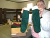 Ruth Reilly holds up one of the 30 pairs of slipper socks for overseas