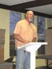 Phil Colquitt, the Latham Springs Baptist Camp director, leads in a Wednesday evening worship service