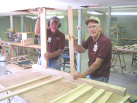 Basil Murphy and Scott Butler are starting to assembly a bunkbed headboard.
