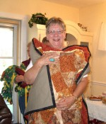 Joyce Smith was thrilled with the lap throw made for her by the group.  The we made for her quilts will be going to help in her deaf ministry with Native Americans.