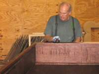 Jim Strong is staining one of the FBC Midlands items.