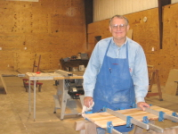 Larry Frantzen is clamping up a drawer front for a file cabinet.