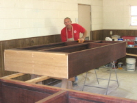 Buddy Nafe, our Furniture Building Ministry leader, stays busy in the paint shop.