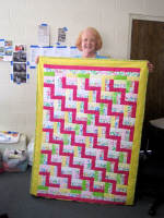 Rita Frantzen shows us the quilt she made for one of the soon-to-be expected arrivals at the camp.  Mom loved it.