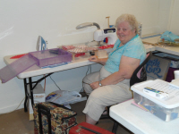 Freda Berry is at her work station making a quilt.