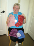 Barbara Cheatheam gets the hats and stockings ready for the River Ministry .