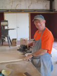 Paul Temple, our East Coaster (from North Carolina), is sanding a night stand top prior to installation.