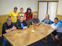 Most of Zephyr's full time staff gathered around their new conference table.