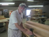 Our newest worker, Harold Hilley, is rounding off a bunch of our square edges with a router.