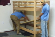 Gary Bishop and Andy Hall, part of the Riverbend Baptist Camp maintenance team, are assembling one of their 60 new bunk beds.